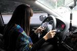 全国人大常委会委员:开车时玩手机应入刑