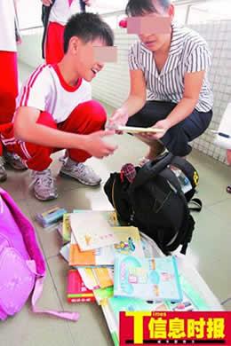 调查显示广州多数小学生书包超体重10%