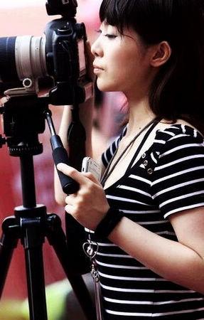 中国最靓丽的美女摄影记者