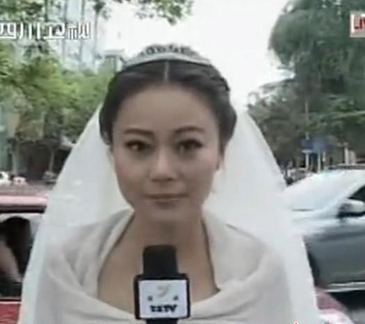 雅安地震穿婚纱报道_女主播穿婚纱播报雅安地震