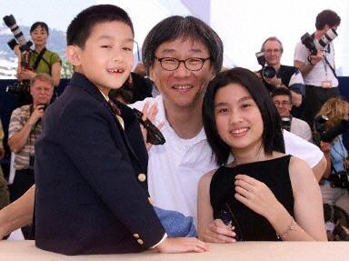 资料图片:杨德昌与《一一》两位主演在戛纳