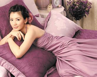 贾静雯带女儿返台迟疑是否接演《醉长安》(图)