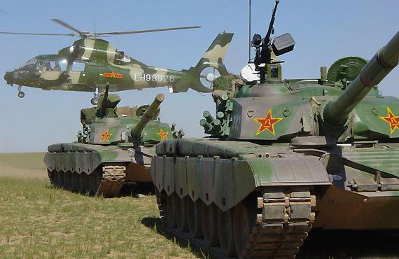 北京军区机步旅与多兵种协同进行实兵对抗演练
