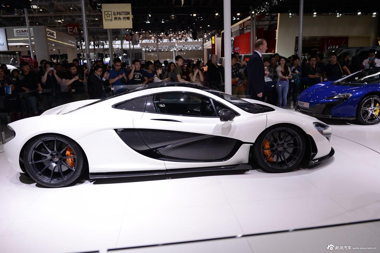 2014(第十三届)北京国际汽车展览会于4月21日至29日在中国国际展览中心新馆(天竺)正式向观众开放,本届车展全球跨国汽车公司悉数到场,室内展馆17个加上室外展场总面积达23万平方米。图为:2014款迈凯轮P1