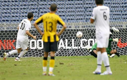图文-[亚洲杯]乌兹别克VS马来西亚巴卡耶夫罚点球