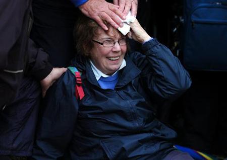 图文-英国公开赛第三轮老虎右曲小球奔向妇女