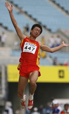图文-田径世锦赛男子跳远资格赛张晓一腾空而起