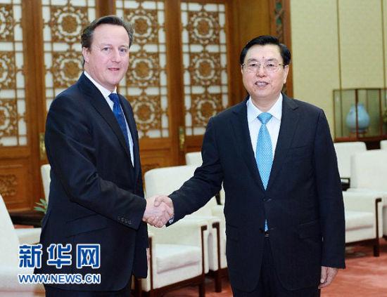 12月2日,全国人大常委会委员长张德江在北京人民大会堂会见英国首相卡梅伦。 新华社记者 李涛 摄