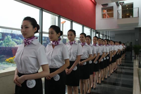 操空姐影院_南航7月10日举行亚运空姐总决赛(组图)